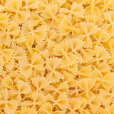 Italian Farfalle Pasta raw food background Royalty Free Stock Images