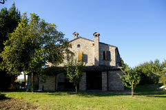Italian farmhouse and trees. A farm house in Marche, Italy in the morning royalty free stock photo