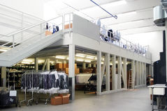 Italian fashion, clothing factory - Warehouse Stock Images