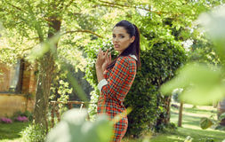 Italian fashion woman in sunny garden . Stock Photography
