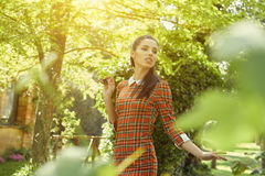 Italian fashion woman in sunny garden . Stock Image