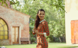 Italian fashion woman in sunny garden . Royalty Free Stock Photo