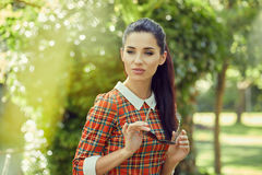 Italian fashion woman in sunny garden . Royalty Free Stock Photography