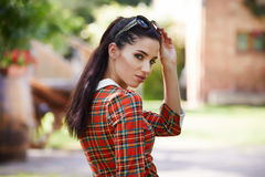 Italian fashion woman in sunny garden . Stock Photos