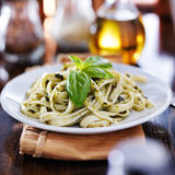 Italian fettuccine in basil pesto sauce Royalty Free Stock Images