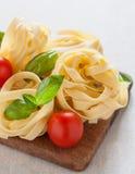 Italian fettuccine nests Stock Photos
