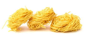 Italian fettuccine pasta. Raw homemade pasta, isolated on white Royalty Free Stock Images