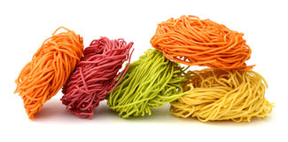 Italian fettuccine pasta. Raw homemade pasta, isolated on white Stock Images