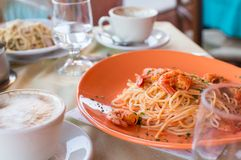 Italian fettuccine and spaghetti with cheese in Stock Photography