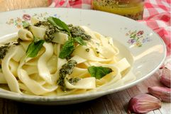 Italian fetuccini with pesto sauce salsa oil and basil Stock Photography