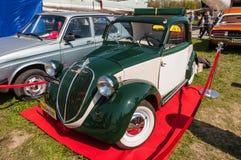 Italian fiat 500 Topolino vintage car. Kyiv, Ukraine - April 26, 2015: The festival Old Car Fest 2015, showed an elegant vintage Fiat 500 car, commonly known as Royalty Free Stock Photos