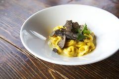 Tortellini with black truffle royalty free stock photos
