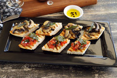 Italian Finger Food. A selection of finger food with mushrooms, tomato and onion including brushette and dips royalty free stock image