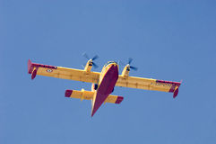 Italian fire fighting plane. Flys to pick up water to assist Greek fire fighters in battle to extinguish forest fires Royalty Free Stock Photos