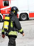 Italian firefighter with the oxygen cylinder and the helmet Stock Photos
