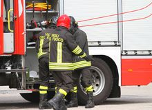 Italian firefighters near fire truck by preparing to put out the Stock Photo