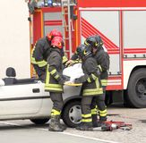 Italian firefighters relieve an injured after car accident Royalty Free Stock Photo