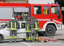 Italian firefighters relieve an injured after a road accident Royalty Free Stock Photography