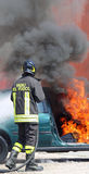 Italian fireman extinguished the car fire Stock Image