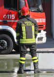 Italian fireman with protective uniform and helmet on h Royalty Free Stock Photo