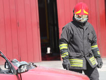 Italian fireman with protective uniform and red helmet Stock Image