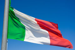 Italian flag. Waving in the blue sky stock photos