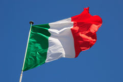 Italian Flag. Italian green, white and red flag fluttering in the breeze stock photo