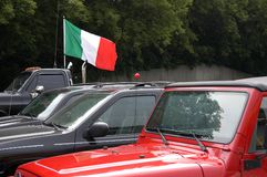 Italian Flag. An Italian flag on a black SUV in a parking lot Royalty Free Stock Photos