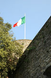 Italian Flag. Under blue sky on a historical toerw in Bergamo Royalty Free Stock Images