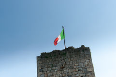 Italian flag above historic stone wall. Royalty Free Stock Photos