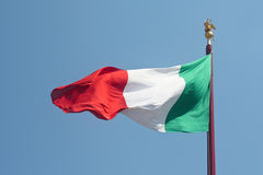 Italian flag against blue sky Stock Image