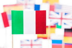 Italian flag against European Union members flags. Close-up picture of Italian flag against European Union member-states flags Stock Images