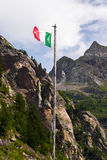 Italian flag in the Alps. Italian flag on a grungy pole at the Toce waterfall Stock Photography