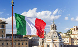 Italian flag on the background of the Cathedral and the blue sky Stock Image