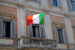Italian flag on a balcony in Rome Stock Photo
