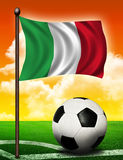 Italian flag and ball. On soccer field Stock Images