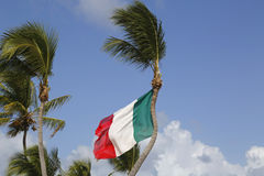 Italian Flag at Bavaro Beach in Dominican Republic. Italian Flag at Bavaro Beach, Dominican Republic Royalty Free Stock Images