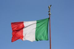 Italian flag in blue sky Stock Photography