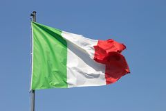 Italian flag. On the blue sky royalty free stock photography