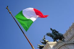 Italian flag, blue sky, architecture. Good quality bright photo of italian flag. You may see tall flag pole with some metal eagle at the top, large bright stock photos