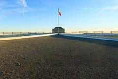 Italian flag on blue sky Royalty Free Stock Photo