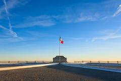 Italian flag on blue sky Royalty Free Stock Images