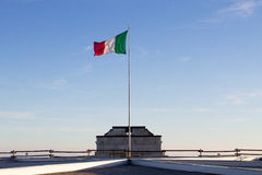 Italian flag on blue sky Royalty Free Stock Image