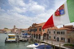 Italian flag closeup view with island of Murano shore Stock Image