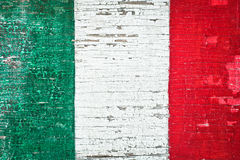 Italian flag. Colors of the Italian flag painted on a weathered wood background stock image
