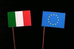 Italian flag with European Union EU flag  on black. Background Royalty Free Stock Photos