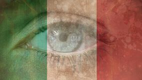 Italian Flag with eye. Composite of Opening and closing Eye against Italian Flag with stains background stock video footage
