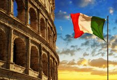 Italian flag with Flavian Amphitheatre or Colosseum at sunset. Royalty Free Stock Image