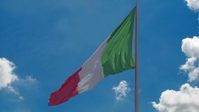 Italian flag flying against blue sky background, country's national symbol. Stock footage stock footage