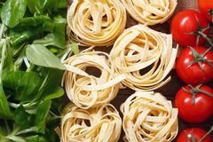 Italian flag with food ingridients. Italian flag of greens, pasta and tomatoes Stock Photo